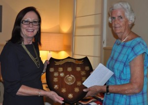 """Winner of the I Sweeney Shield - Jenny Schall (representing """"Bogabigal Pastoral Co."""" (on right) being presented with the shield by Mayor Phyllis Miller"""