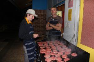 Oliver Carlise and Mr West cooking dinner