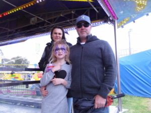 belinda-separovic-naarah-tim-childs-wait-for-their-turn-on-the-dodgem-cars